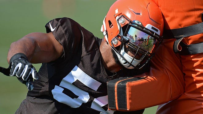Browns defensive end Olivier Vernon works in a drill during training camp last summer in Berea.