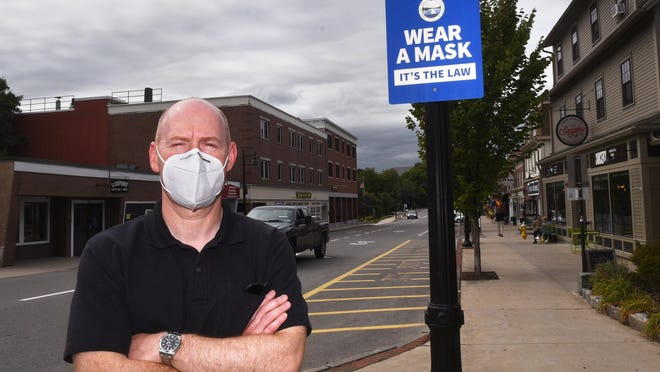Town Administrator Todd Selig reminds people that wearing masks is the law in Durham, home to the University of New Hampshire campus.