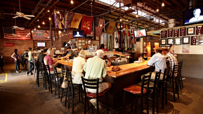 """The growth of Four Peaks Brewing Co. threatens its right to sell its own beer at its pubs, including this one in Tempe. Some sma;; Arizona brewers are outgrowing their """"micro"""" status."""