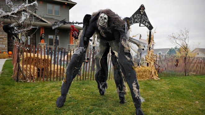 Brad Schindele, Cold Spring, works on his Halloween display Thursday in Cold Spring. Wearing stilts and arm extensions, he is sure to scare children and adults.