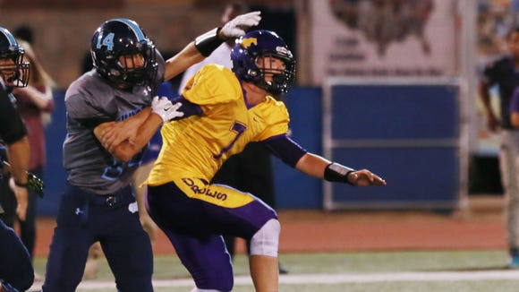 Chapin defender Jesus Corral, left, battled Burges receiver Ryan Salazar for the ball on a pass play Thursday. The pass fell incomplete.