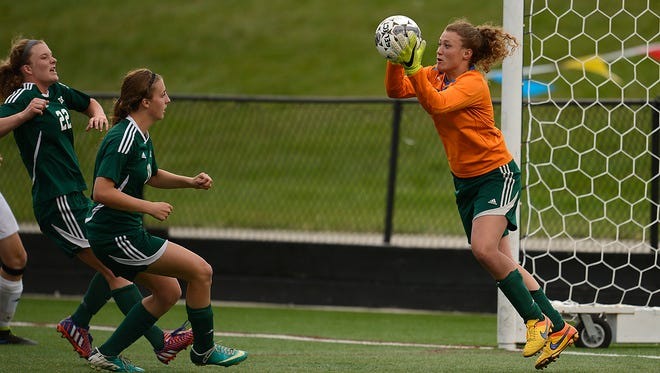 D.C. Everest goalie Steph Meuret (0) makes a save against Kettle Moraine in overtime during Saturday's Division 1 championship game in the WIAA state girls soccer tournament at Uihlein Soccer Park in Milwaukee.