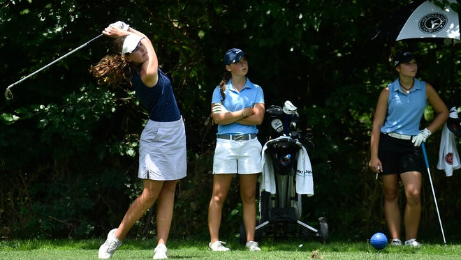 Maria Connelly (left) drives her ball during the last day of the Ohio Junior Girls Championship held at the Marion Country Club on Tuesday. Connelly won the tournament by four strokes with a 3-over-par 145.