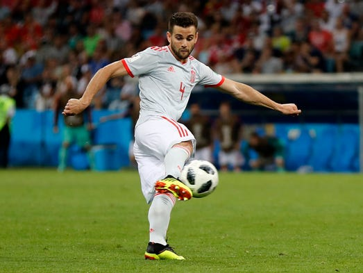 Spain's Nacho scores his side's third goal against