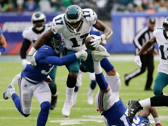 Eagles wide receiver Alshon Jeffery (17) leaps over