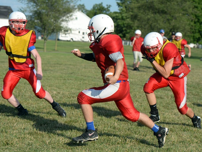 Union County High School football players practice Wednesday, Aug. 13, 2014 in Liberty.