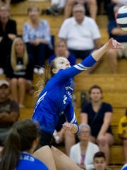 Barron Collier's Dayna Grigsy (2) hits the ball during the Class 7A District 12 Championship game against Naples High School Thursday, October 20, 2016 in Naples.