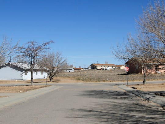 The Bluffview Housing Community, a Navajo Housing Authority neighborhood located south of Farmington, is pictured on Friday. Many of the community's residents say they were not familiar with an NHA policy that requires all members of a household that is involved in a domestic violence incident to be evicted. DNA People's Legal Services is suing the tribal agency to discontinue the policy.