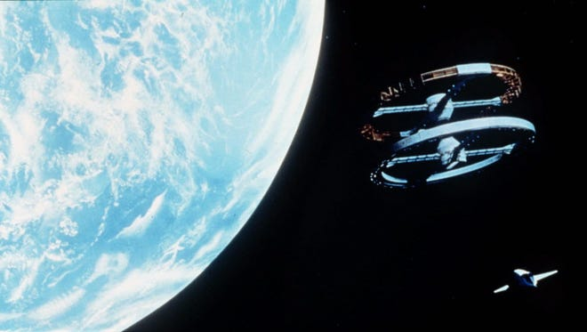 """A scene from Stanley Kubrick's 1968 film, """"2001: ASpaceOdyssey,"""" showing aspaceshuttle, lower right, approching aspacestation."""