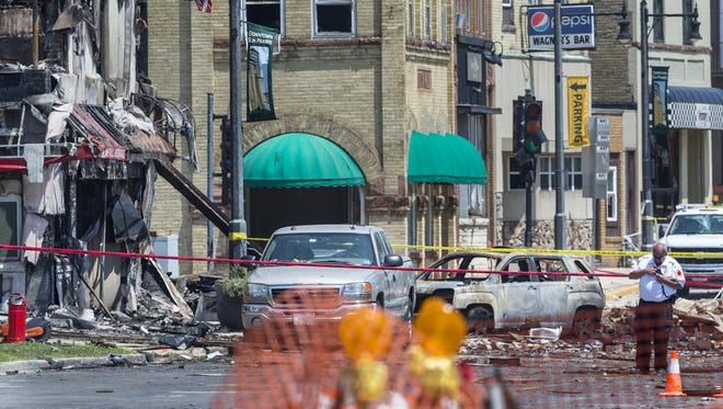 A gas leak explosion destroyed at least four buildings on Wednesday in Sun Prairie, killing a firefighter.