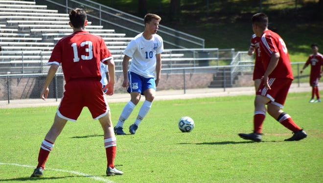 Robert E. Lee's Kyle Stenzel looks for an opening during the Leemen's 8-0 victory over Stonewall Jackson in the Shenandoah District boys soccer tournament championship game on Friday, May 25, 2018, at Winston-Wine Memorial Stadium in Staunton, Va. Stenzel scored four goals for the Leemen