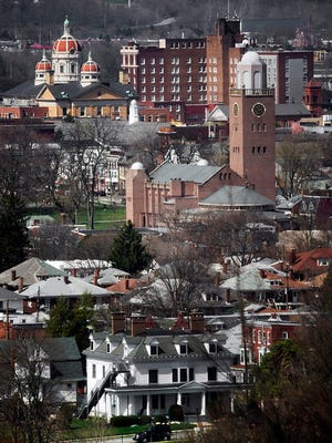 Looking across York from a York College student residence (white building at the bottom) across York. The rounded tower is Zion United Church of Christ at the edge of Penn Park on Lafayette Street and the tall buildings in the background are the York County Administrative Center and the Yorktowne Hotel on East Market Street Sunday April 14, 2015. Paul Kuehnel - Daily Record/Sunday News