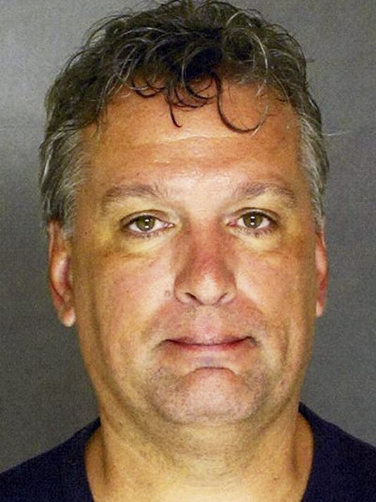 Gregory Hess is accused of trying to hire a hit man to kill his estranged wife's boyfriend.