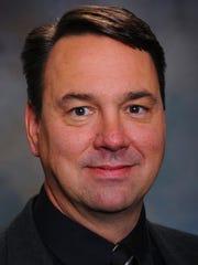St. Norbert College men's hockey coach Tim Coghlin
