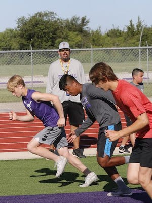 Daniel Price, who is entering his first year as athletic director and head football coach at Early High School, watches as athletes run summer conditioning drills Thursday morning at Longhorn Stadium.
