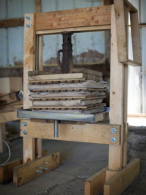 An upcoming class in Tompkins County will teach students how to build a rack-and-cloth cider press, which tends to extract more juice per apple than a barrel-style press. Provided photo.