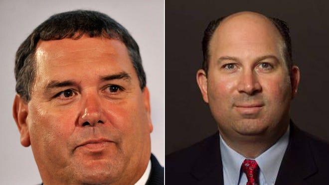 Brady Hoke (left) of Michigan and Pete Lembo (right) of Ball State
