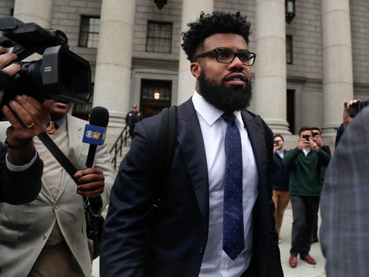 FILE - In this Thursday, Nov. 9, 2017, file photo, Dallas Cowboys NFL football star Ezekiel Elliott walks out of federal court in New York.   Elliott's half-season run from his six-game suspension ended when a federal appeals court refused to let him play while it considers his appeal. (AP Photo/Julie Jacobson, File)