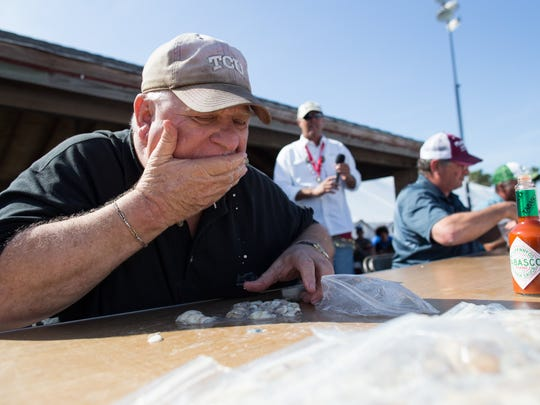 Joel Pruitt of Rockport Texas competes in the mens oyster eating contest at 37th Annual Fulton Oysterfest in Fulton Texas, Saturday, Mar. 5, 2016. Joel won the contest after eating 261 oysters in the five minutes.