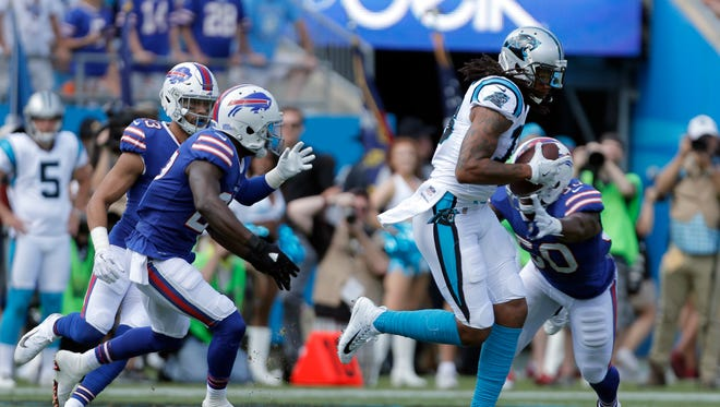 Carolina Panthers' Kelvin Benjamin, right, runs after a catch against the Buffalo Bills in the first half of an NFL football game in Charlotte, N.C., Sunday, Sept. 17, 2017. (AP Photo/Bob Leverone)