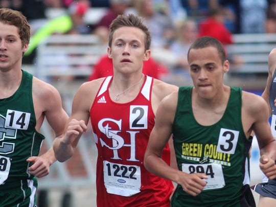 St. Henry senior Ethan Snyder runs the 1600 during