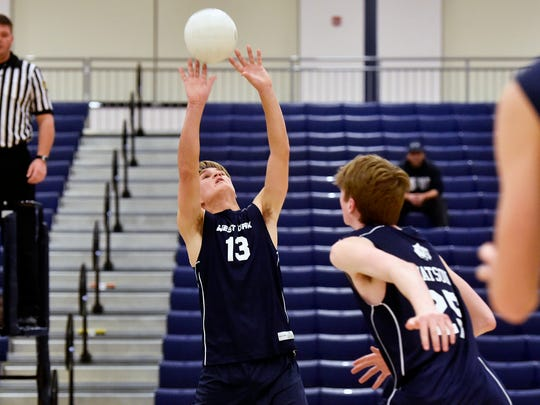 West York's Jacob May sets the ball in a match against Antietam Thursday, April 7, 2016, at West York. The West York boys volleyball team is in rebuilding mode after three returning seniors and one returning junior decided not to play this year after last year's 2-10 season.