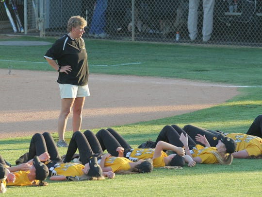 Michelle Parnell watches over Crescent players doing situps after a 2-0 win over Hanahan after the first game of the Class AAA Softball State Series in Iva on Monday.