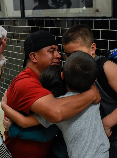 Antonio Cuahua (second from left) embraces his children, Cecily Cuahua, 10; Anthony Cuahua, 8; Marrissiah Cuahua, 6, and Enrique Cuahua, 5, on Jan. 11 after they arrived at the Veracruz International Airport in Veracruz, Mexico. The children are immigrating to Mexico to live with their father, who was deported after being arrested by ICE in September n Owensboro, Kentucky. The children, who are all U.S. citizens, have never been to Mexico before and do not speak Spanish.