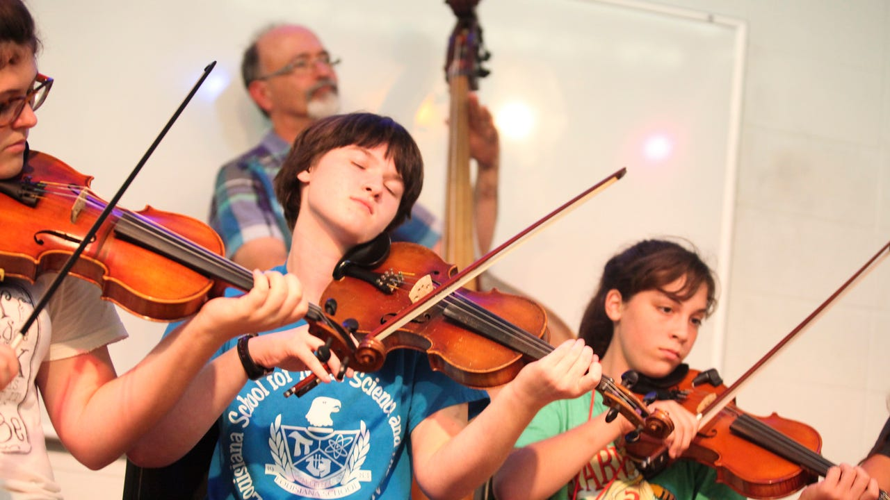 Lucy Rythms plays fiddle in the finale of the Louisiana Folk Roots Kids Camp performed at Angelle Hall in Lafayette July 27.