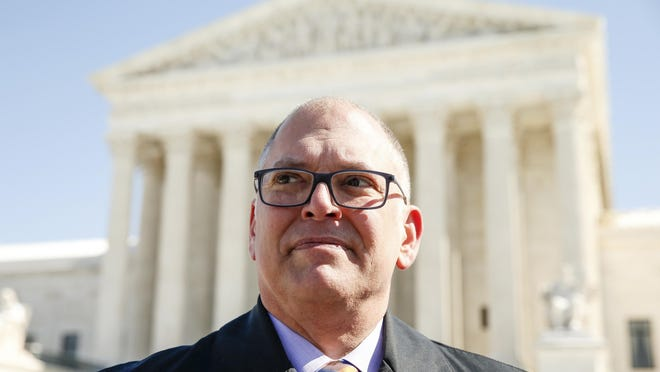 Jim Obergefell stands in front of the U.S. Supreme Court.