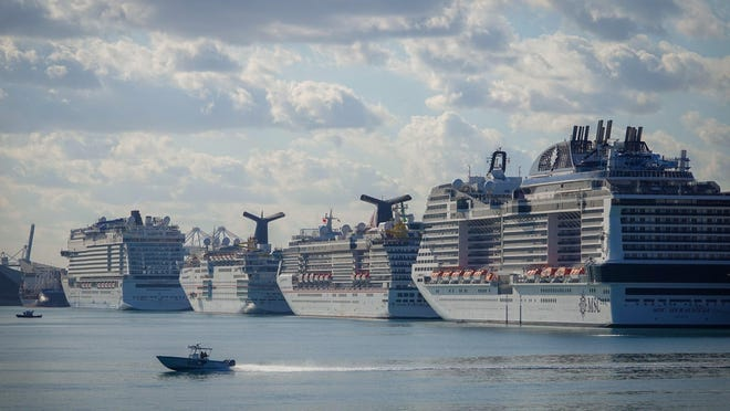 FILE -- Cruise ships docked at the Port of Miami on Saturday, April 4, 2020. The Carnival Corporation, the giant cruise company widely criticized for its handling of the coronavirus pandemic, announced on Monday that some of its ships may begin sailing again as soon as August.