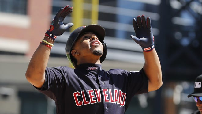 Cleveland Indians' Francisco Lindor looks skyward as he crosses home plate after a solo home run during the third inning of a baseball game against the Detroit Tigers, Thursday, Aug. 29, 2019, in Detroit.