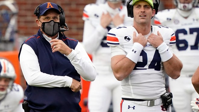 Auburn head coach Gus Malzahn, left, and quarterback Cord Sandberg (24) watch from the sidelines during an SEC game against Mississippi in Oxford, Miss., on Oct. 24.