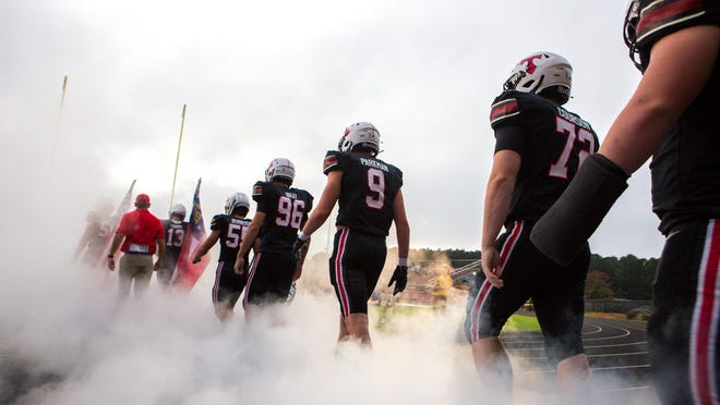 The North Oconee Titans walk onto the field before the start of a varsity high school football game between the North Oconee Titans and the Benedictine Cadets at North Oconee High School in Bogart, Ga., on Friday, Sept. 25, 2020. Despite a North Oconee comeback attempt in the second half, Benedictine held onto the lead to win 49-35.