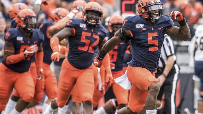 Illinois Milo Eifler (5) celebrates a fumble recovery in the first half against Akron on Aug. 31, 2019, in Champaign.