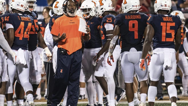 Illinois football coach Lovie Smith talks to members of his team in the second half of a game between Illinois and Nebraska on Saturday, Sept.21, 2019, in Champaign.