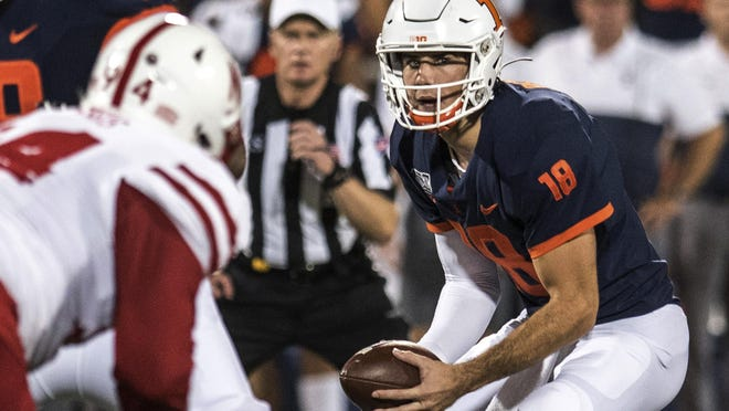 Illinois quarterback Brandon Peters (18) looks to pass in the first half of a game between Illinois and Nebraska on Saturday, Sept.21, 2019, in Champaign.