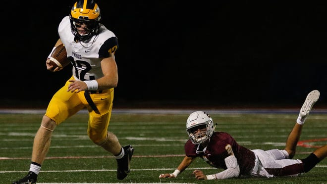 Prince Avenue's Brock Vandagriff (12) runs the ball during an GHSA high school football game between Holy Innocents Episcopal and Prince Avenue Christian in Sandy Springs, Ga., on Friday, Sept. 25, 2020. Prince Avenue defeated Holy Innocents, 35-25.