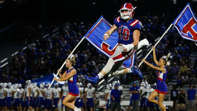 Jefferson's Paxton Corkery (10) races onto the field to mark the beginning of a GHSA high school football game between Jefferson High School and Oconee County High School in Jefferson, Ga., on Friday, Aug. 23, 2019.
