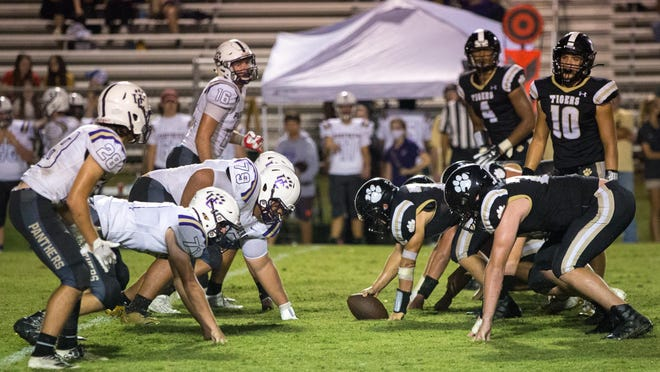 Commerce and Union County line up before a play during the second half of a varsity high school football game between the Commerce Tigers and the Union County Panthers at Commerce High School in Commerce, Ga., on Friday, Sept. 11, 2020. Commerce went on to beat Union County 32-14.