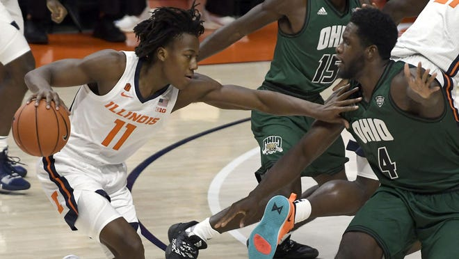 Illinois' Ayo Dosunmu pushes past Ohio's forward Dwight Wilson III Friday, Nov. 27, 2020, in Champaign.