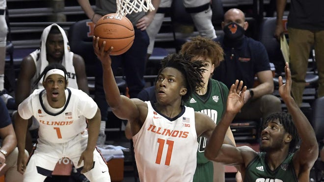 Illinois guard Ayo Dosunmu shoots against Ohio guard Lunden McDay in the second half Friday in Champaign.