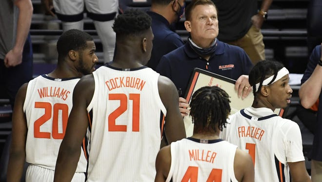 Illinois head coach Brad Underwood takes a critical time out late in the second half of an NCAA college basketball game against Ohio, Friday, Nov. 27, 2020, in Champaign.