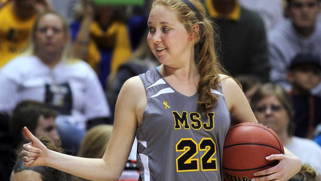 In this Nov. 2, 2014, file photo, Mount St. Joseph's Lauren Hill gives a thumbs-up as she holds the game ball during her first NCAA college basketball game against Hiram University at Xavier University in Cincinnati. (AP)