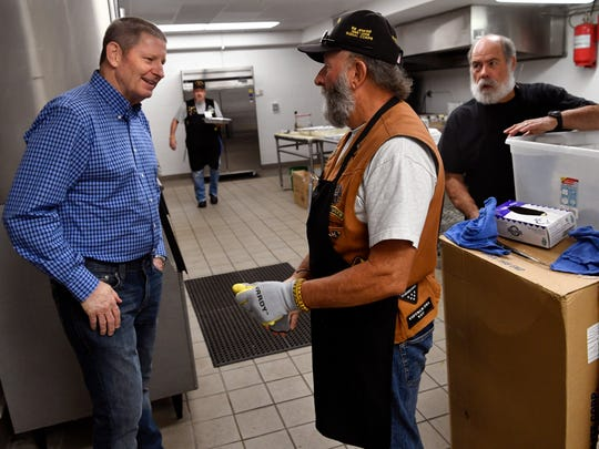 Barry Jenkins, a member of the Patriot Guard and a volunteer in the kitchen at Saturday's 53rd World's Largest Barbecue, meets with U.S. Air Force Gen. Robin Rand, left.