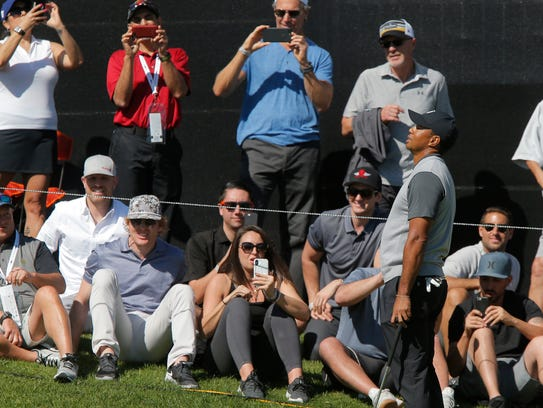 Tiger Woods reacts after missing a birdie putt on the
