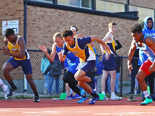 R.J. Khayo, center, from Moeller gets out of the blocks