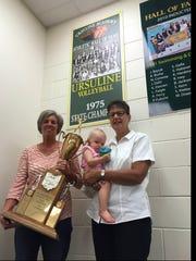 Sue Mackey holds Ursuline's 1975 Class AA state championship