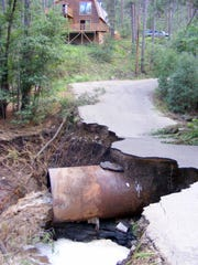 The river ripped out a driveway and damaged a culvert,