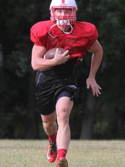 action photos of Bishop Ahr High School football team's practice In Edison. RB/OLB Andrew Brazicki is featured here on Tuesday August 11, 2015